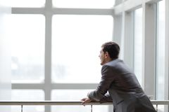 Free Businessman Standing Near The Window And Looking Into It Royalty Free Stock Photography - 136069527