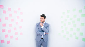 Businessman standing near wall with stickers Royalty Free Stock Image