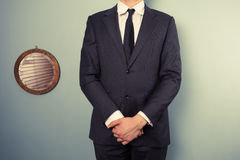 Businessman standing next to mirror Stock Photo