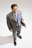 Businessman standing with notebook Stock Photography