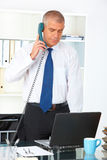 Businessman standing in office Stock Photography