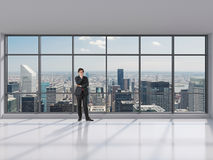 Businessman standing in office Royalty Free Stock Photos