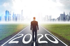 Free Businessman Standing On 2020 Road Stock Images - 163557324