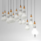 Businessman standing out of 3d pencil and light bulb royalty free stock photos