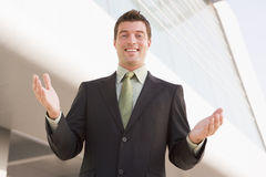 Businessman standing outdoors by building Royalty Free Stock Photography