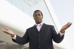 Businessman standing outdoors by building Royalty Free Stock Photo