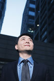 Businessman standing outdoors, low angle view, Beijing Royalty Free Stock Photos