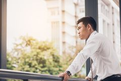 Businessman standing with outside company and looking future. royalty free stock photos