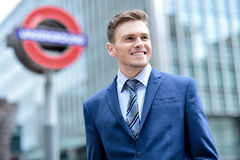 Businessman standing outside modern building Royalty Free Stock Image