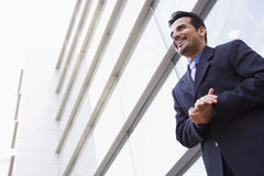 Businessman standing outside office building Stock Photos