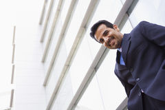 Businessman standing outside office building Stock Photography