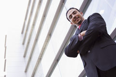 Businessman standing outside office building. Looking to camera Royalty Free Stock Photo