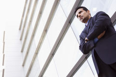 Businessman standing outside office building Royalty Free Stock Photos
