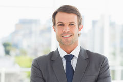 Businessman standing over blurred background outdoors Royalty Free Stock Photos