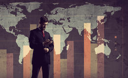 Businessman standing over diagram. World map background. Busines. S, globalization, worldwide concept Stock Photos