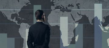 Businessman standing over diagram. World map background. Busines. S, globalization, worldwide concept Stock Image