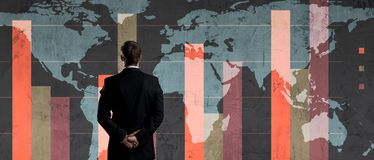 Businessman over dark background. World map background. Business, globalization, capitalism concept. Businessman standing over diagram. World map background royalty free stock images
