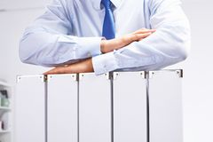 Businessman standing over a folder with documents stock images