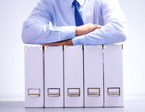 Businessman standing over a folder with documents Royalty Free Stock Image
