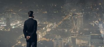 Businessman standing over night city background. Job, business, career concept Stock Photo