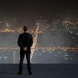 Businessman standing over night city background. Job, business, career, concept Royalty Free Stock Photo