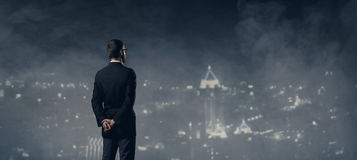 Businessman standing over night city background.  Job, business,. Career, concept Royalty Free Stock Photography
