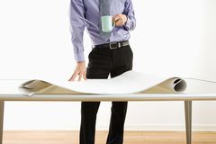 Businessman standing over plans. Royalty Free Stock Photography