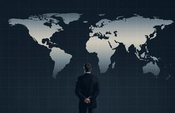 Businessman. Business, office and financial concept. Businessman standing over world map background. Business, globalization, concept Stock Photography