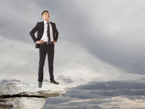 Businessman standing on a peak Royalty Free Stock Image