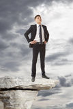 Businessman standing on a peak Royalty Free Stock Photos