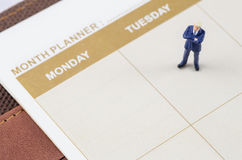 Businessman standing on the planner book Stock Images