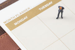 Businessman standing on the planner book Royalty Free Stock Image