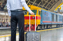 Businessman standing on the platform of a train station Royalty Free Stock Photo