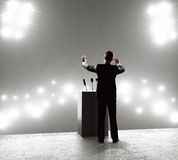 Businessman standing on podium Royalty Free Stock Photography