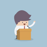 Businessman standing on podium and giving a speech Royalty Free Stock Image