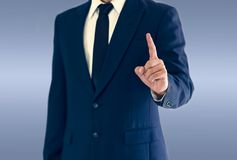 A businessman is standing and pointing hand. Copy space for your text royalty free stock photos