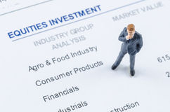 Businessman standing on the portfolio investment Stock Image