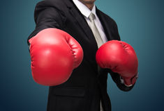 Businessman standing posture in boxing gloves isolated Stock Photography