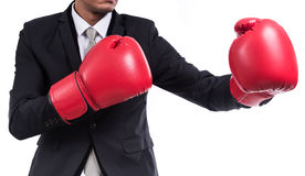 Businessman standing posture with boxing gloves Royalty Free Stock Photography