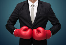 Businessman standing posture in boxing gloves  Stock Photography