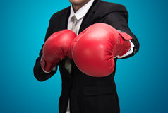 Businessman standing posture in boxing gloves  Royalty Free Stock Photography