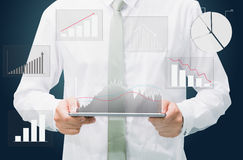 Businessman standing posture hand graph on tablet  Stock Images