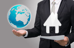 Businessman standing posture hand hold earth showing graph isola Royalty Free Stock Photos