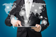 Businessman standing posture hand hold globe map on tablet Stock Photography