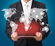 Businessman standing posture hand hold globe map on tablet Stock Photos