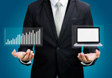 Businessman standing posture hand hold laptop showing graph isol Stock Image