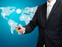 Businessman standing posture hand hold mobile phone Global Marke Royalty Free Stock Images