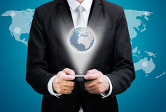 Businessman standing posture hand hold mobile phone Global Marke Stock Photography