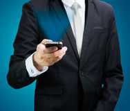 Businessman standing posture hand hold mobile phone isolated Stock Photo
