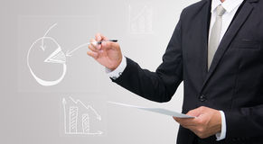 Businessman standing posture hand hold a pen  Stock Images
